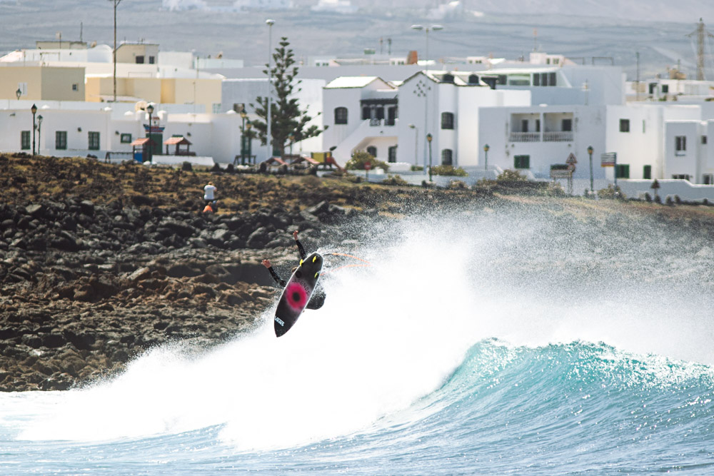 Lanzarote is a perfect playground for airs with strong winds allowing for maximum and protection. Here, Seb throws a big rotator into the flat.