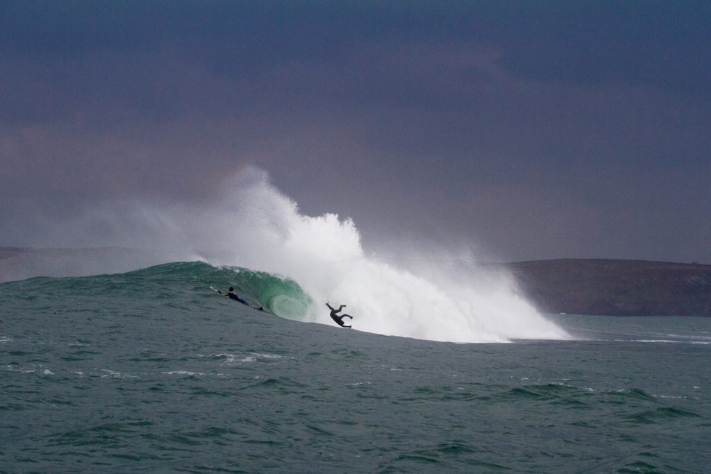Local surfer Dicky take a nasty inverted trip over the ledge. Photo Luke Gartside